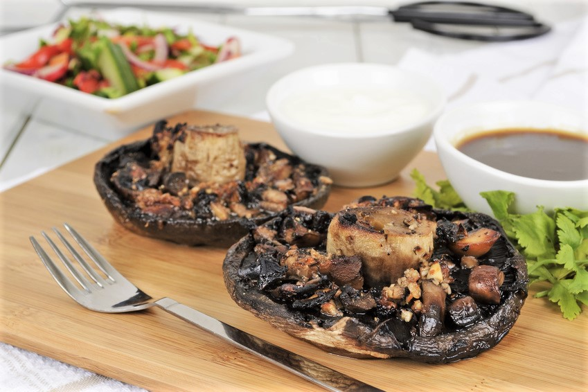 Grilled mushrooms with salad BBQ sauce and and sour cream dip